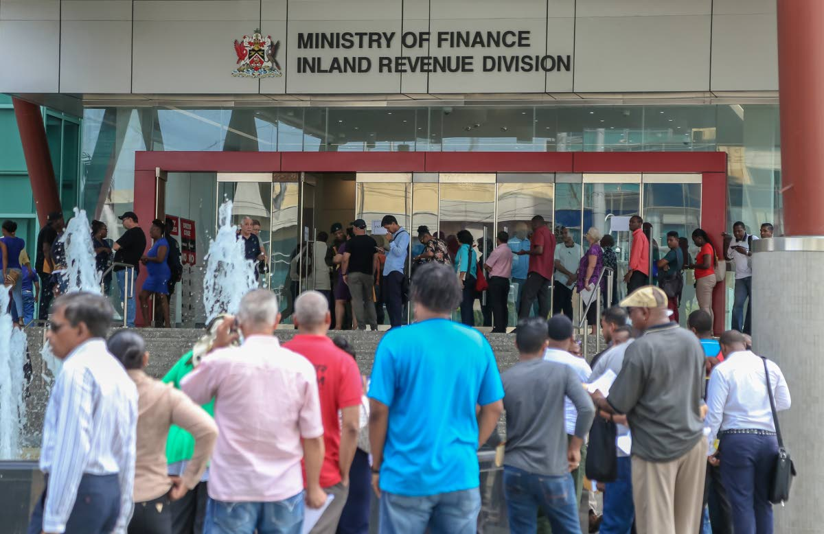 Long lines were the order of the day on Friday as hundreds rushed to pay their taxes at the Government Campus in Port of Spain on the last  working day of the three-month tax amnesty.