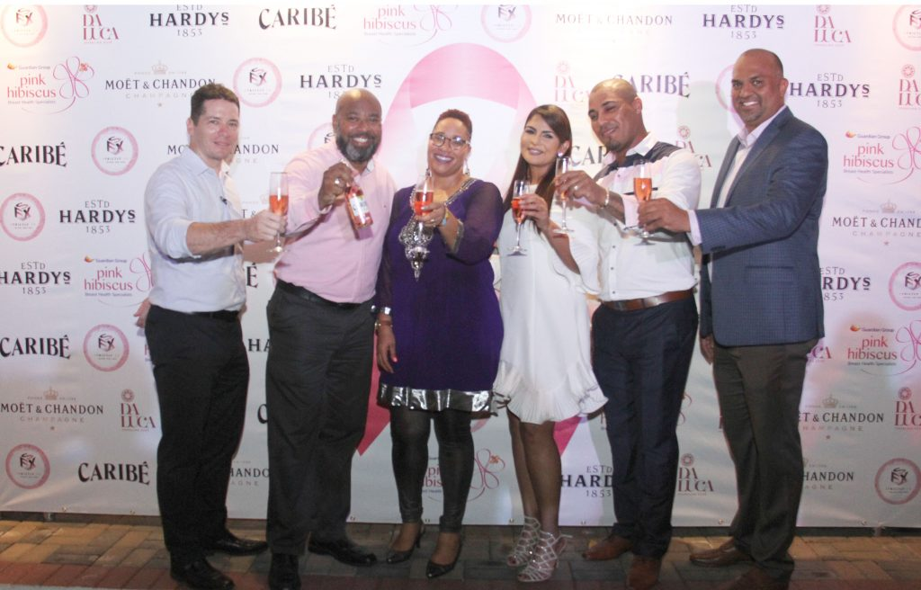 From left, Director of Premium Beverages Division Nicholas Hospedales, Carib Brewery Limited Representative and Head of Lager and Cider Antron Forte, Trinidad and Tobago Cancer Society Chairman Dr. Asante Le Blanc, Host Hema Ramkissoon, Strictly FX Limited, Managing Director and visionary behind PINKnic TTAdrian Chandler and Guardian Life of the Caribbean Limited President and Pink Hibiscus Chairman Anand Pascal at the media launch for cancer awareness at the Brian Lara Residence, Port-of-Spain on September 5.   PHOTO BY AYANNA KINSALE