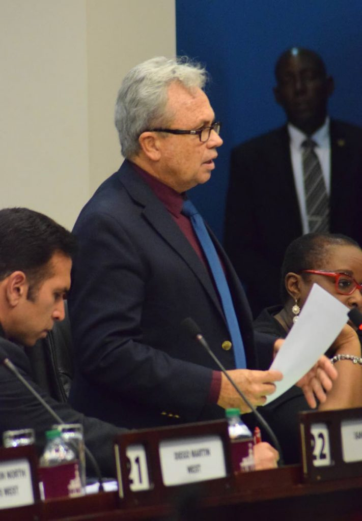 Acting Prime Minister Colm Imbert speaks in Parliament on Friday as Attorney General Faris Al-Rawi and Planning and Development Minister Camille Robinson-Regis look on.