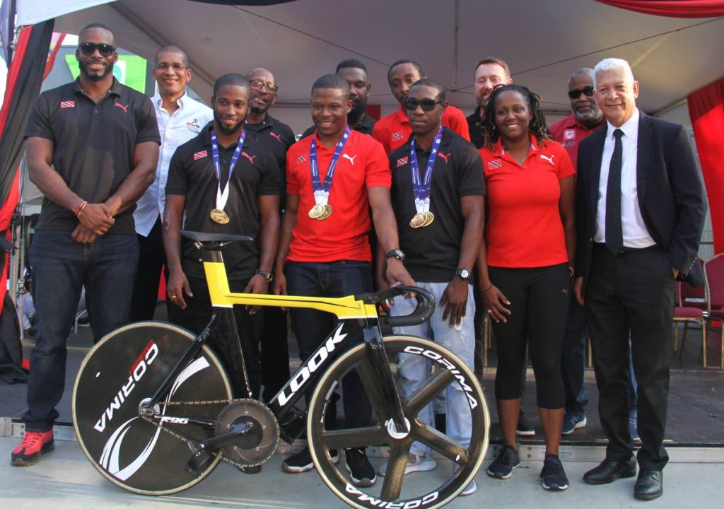 Port of Spain Mayor Joel Martinez, right, joins world record breaking cyclist Nicholas Paul, third from left front row, and the TT cycling team on the Brian Lara Promenade, on Friday. Browne is second from left front row.