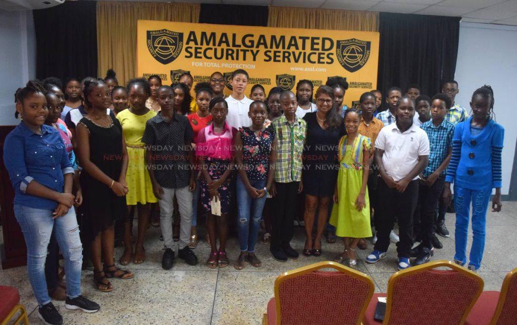 Amalgamated Security Services Ltd CEO Pamela Hosein takes a group photo with SEA grant awardees at Amalgamated Security Centre, Chaguanas on Saturday. PHOTO BY VIDYA THURAB