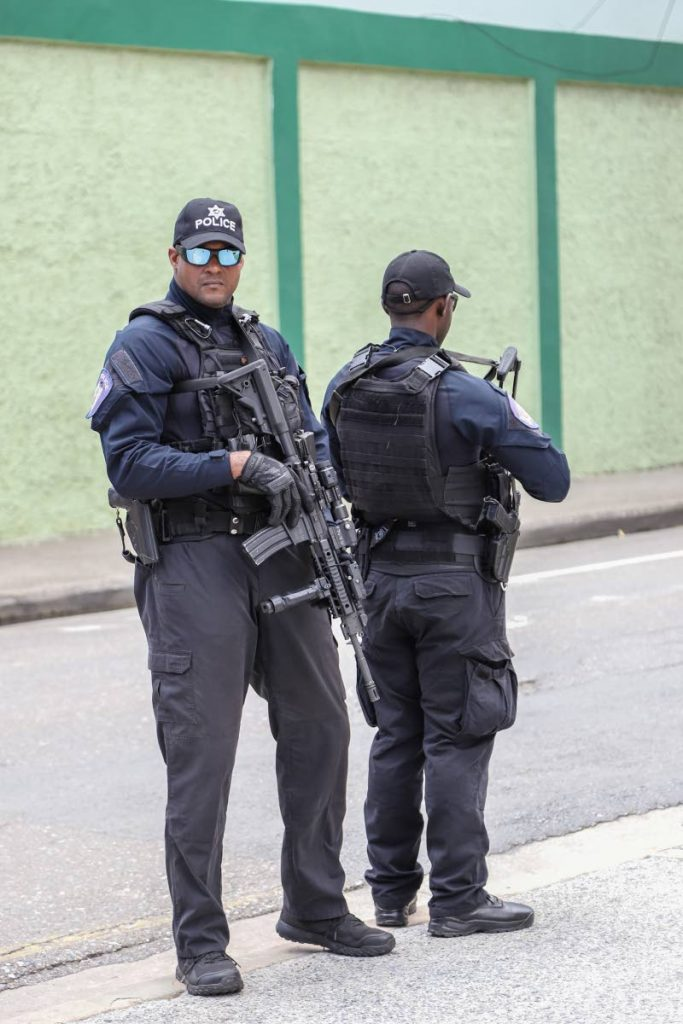 Guard and Emergency Branch officers stand guard on Abercromby Street, outside the Hall of Justice, Port of Spain, during the ceremonial opening of the 2019-2020 law term on Monday. PHOTO BY JEFF K MAYERS