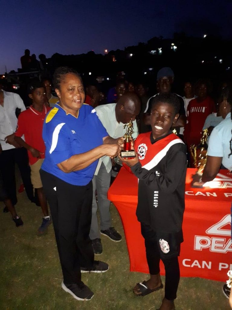Abdul-Quddos Hypolite (right) is all smiles after receiving his trophy as the Under-15's MVP.