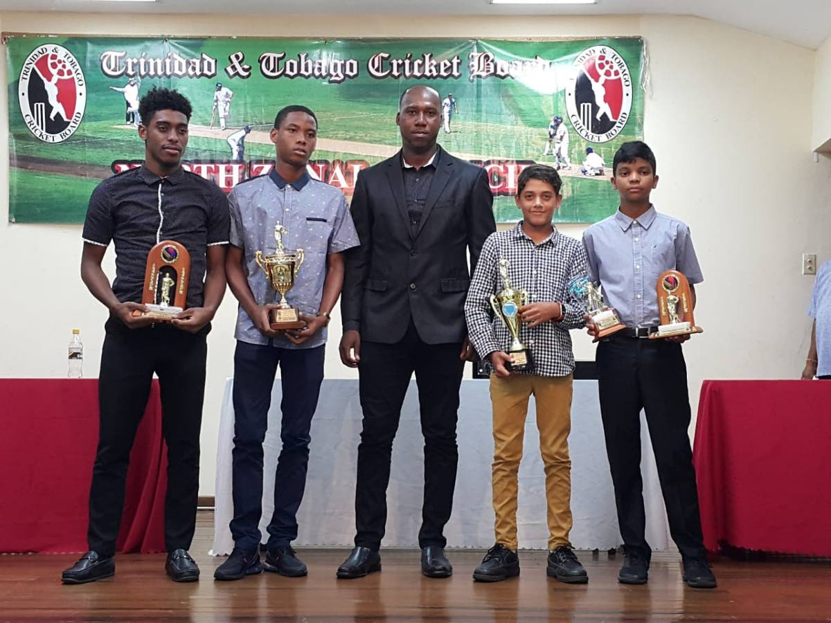 Youth MVPs Giovanni Letren, from left, Chadeon Raymond, Joshua Davis and Rahul Lakhan, along with national cricketer Marlon Richards, middle.