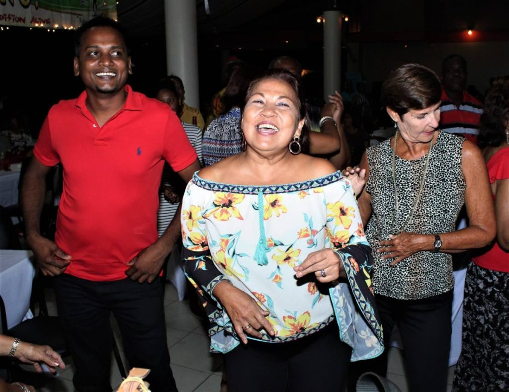 Nadie La Fond enjoys the parang music with friends.