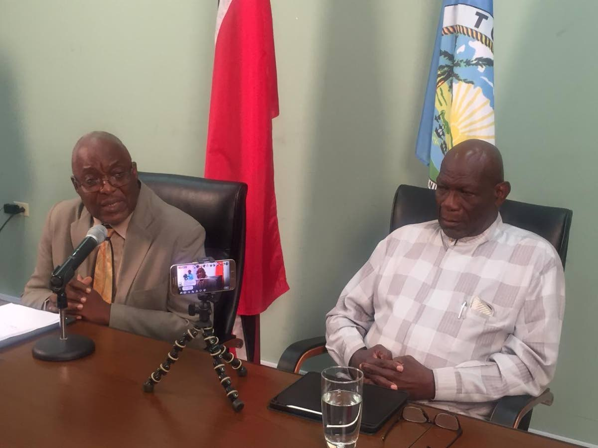 Chief Secretary Kelvin Charles, left, and head of the Airport Relocation Committee Allan Richards at a press conference on Tuesday.