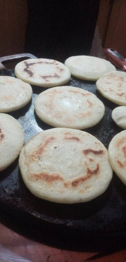 Arepas are cooked on a budare (cast iron griddle).
