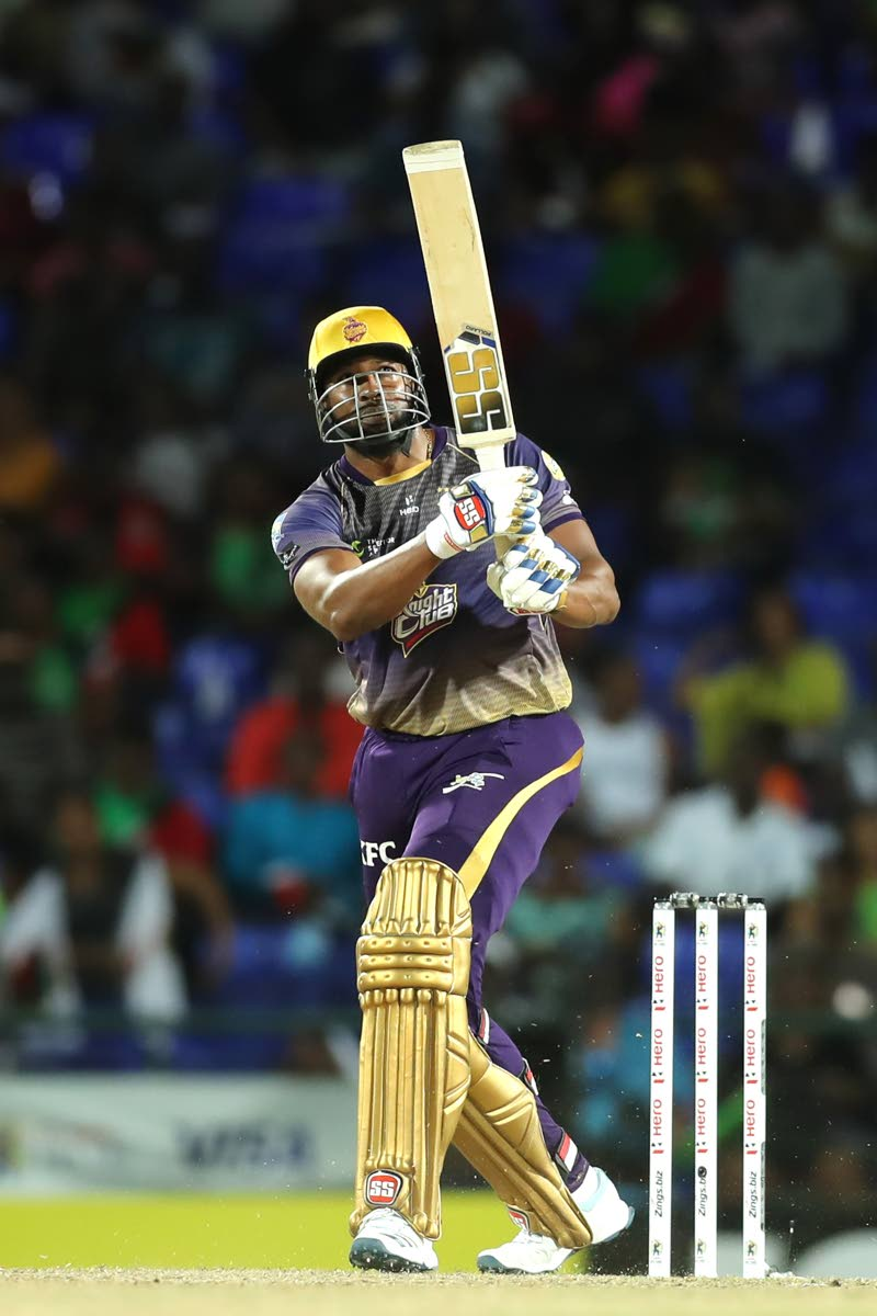 Kieron Pollard of Trinbago Knight Riders (TKR) hits six during the Hero Caribbean Premier League match between St Kitts Nevis Patriots and TKR .