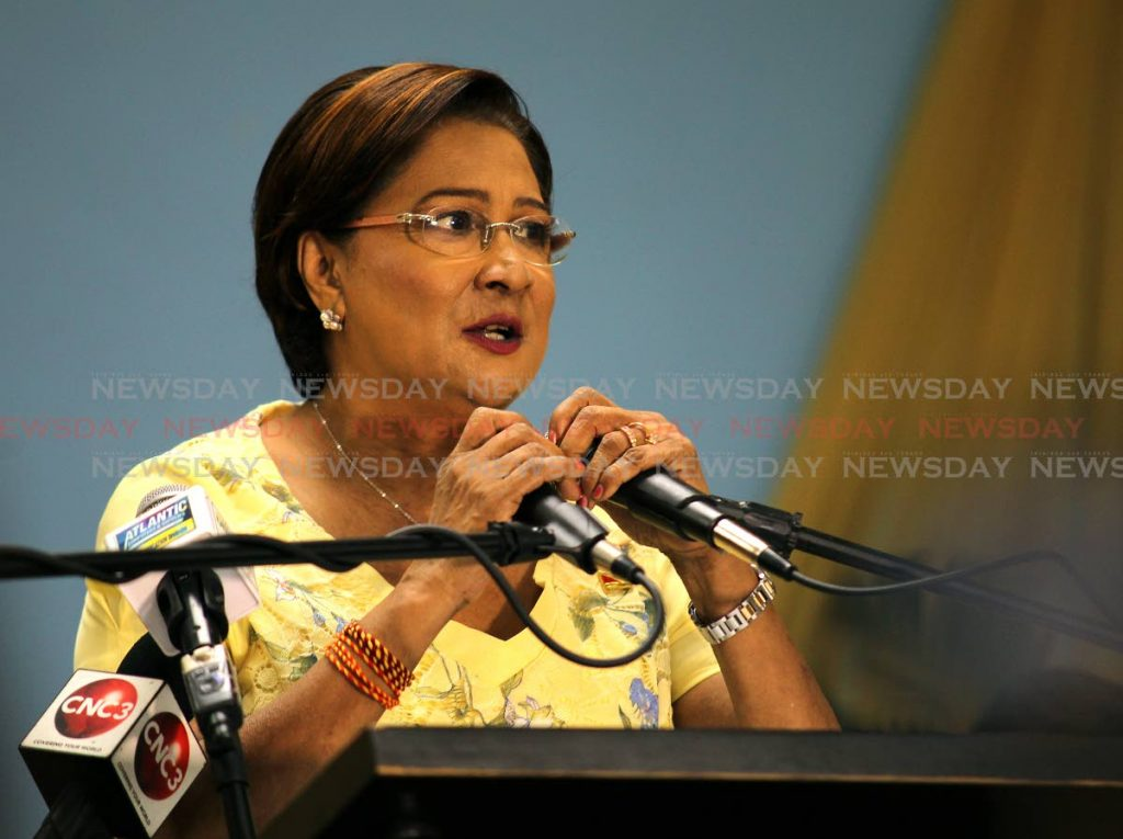 UNC political leader Kamla Persad Bissessar, addressing supporters at the UNC pavement meeting held at the New Grant government primary school, New Grant. Photo by Lincoln Holder