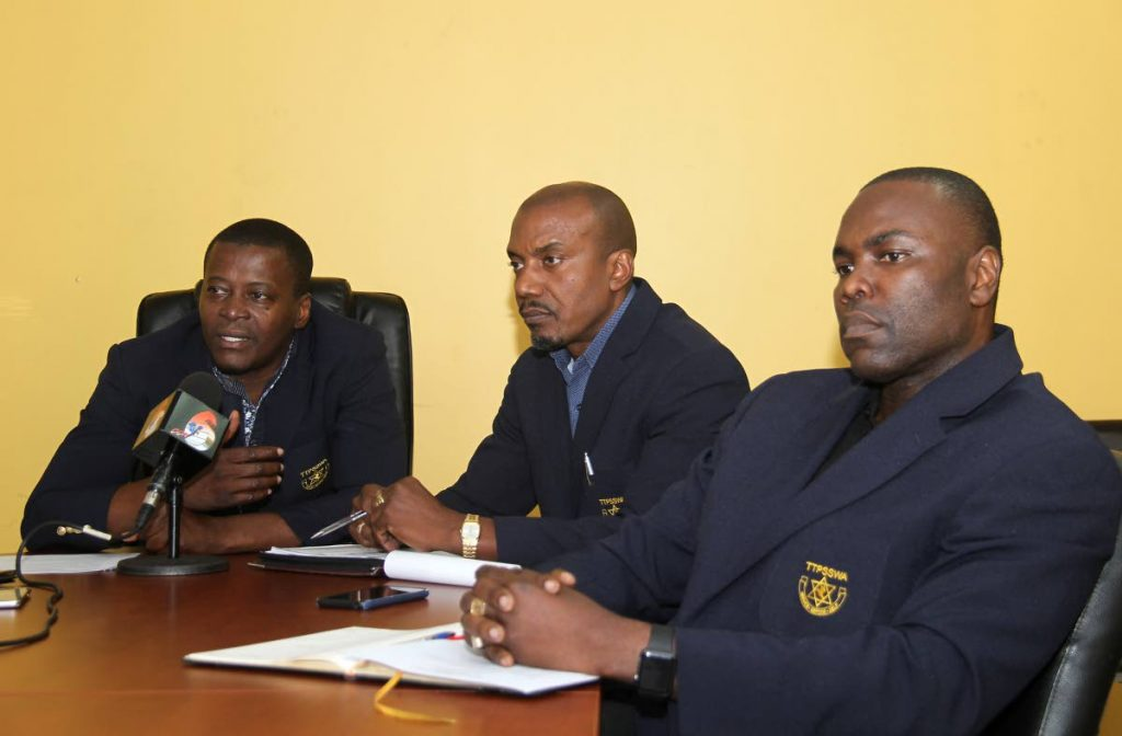 Police Social and Welfare Association president Insp Gideon Dickson, left, during a press conference at the Riverside Plaza, Port of Spain on Friday. Alongside Dickson are secretary Sgt Ancil Forde, centre, and trustee Sgt Ishmael Pitt. PHOTO BY AYANNA KINSALE