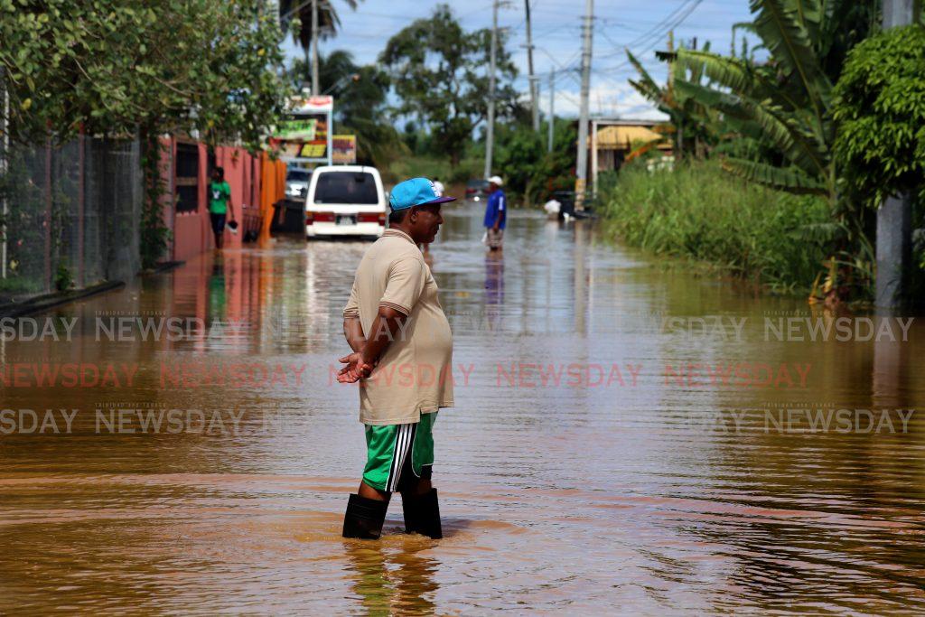 A walk through the flood covered street at  Bamboo No 1 Valsayn PHOTO SUREASH CHOLAI