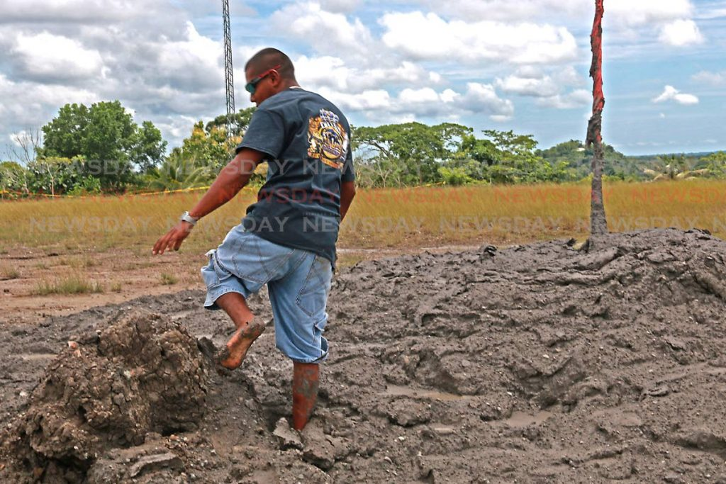 A villager steps in for a closer look at  the mud volcano in Piparo on September 23. PHOTO BY MARVIN HAMILTON