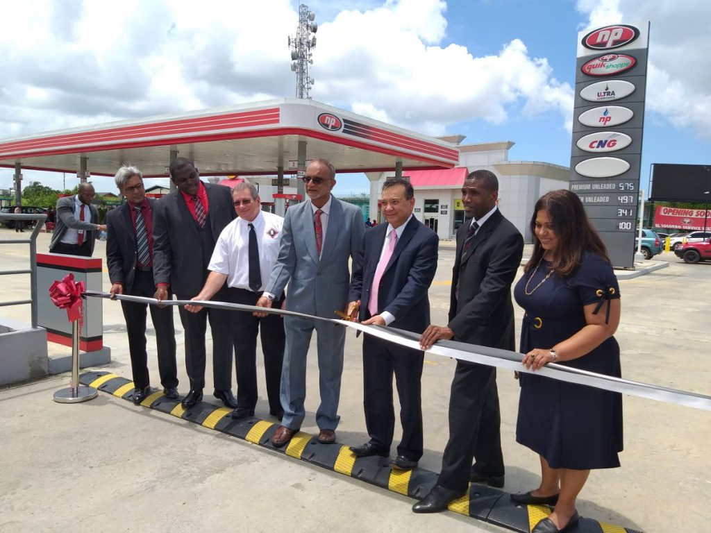 Energy minister Franklin Khan helps cut the ribbon at the official opening of the El Socorro NP Service Station where he defended the Government's recent handling of the former Petrotrin refinery. Photo by Tyrell Gittens