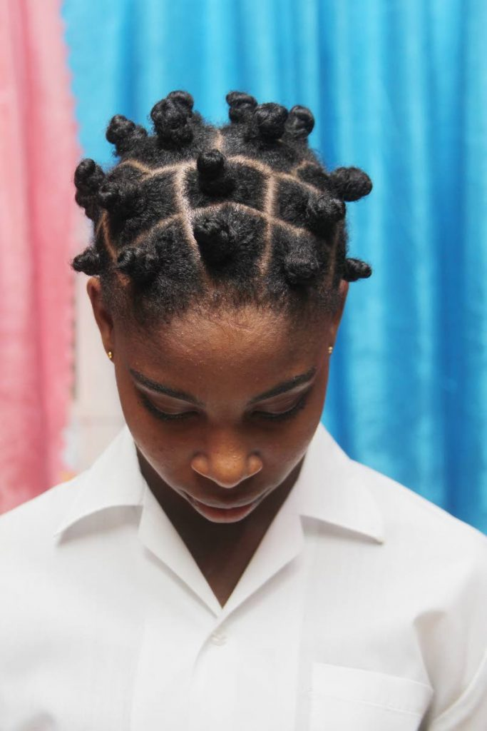 This St Stephen's College student's Bantu knots led her to be warned by school officials about her hairstyle. Her mother's complaint against the school is being investigated by the Education Ministry.