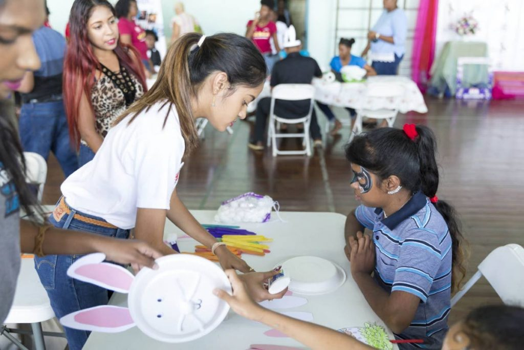 Mahina Seecharan works with a child at Support Autism T&T's (SATT) autism fun day 2019.