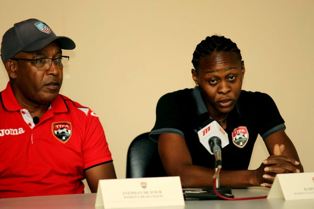 TT women's football team coach Stephan De Four, left, and captain Karyn Forbes speaking at a press conference earlier this year PHOTO BY LINCOLN HOLDER