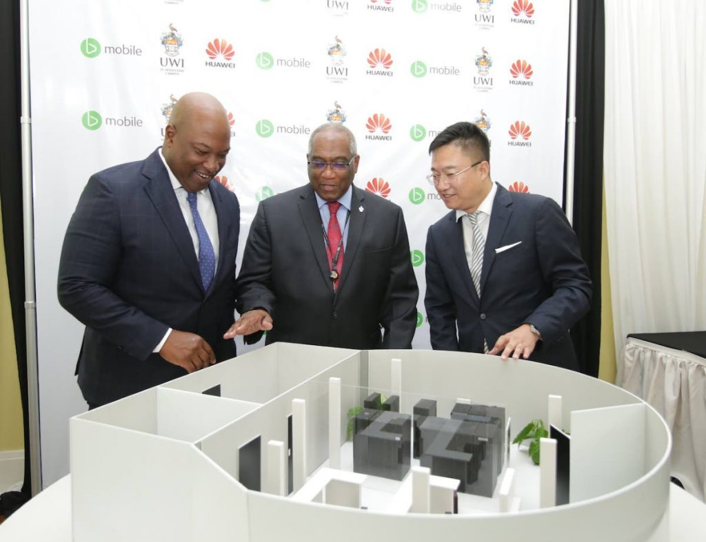 TECH INNOVATION: From Left to Right: TSTT's CEO Dr. Ronald Walcott, UWI St. Augustine's Pro Vice-Chancellor and Campus Principal Professor Brian Copeland and Huawei TT's CEO Jeff Jin view the 3D Model of the bmobile-UWI Innovation Lab, powered by Huawei.