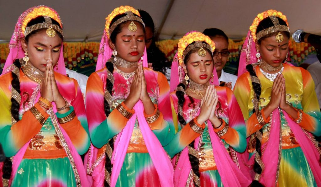 Parvati Girl's Hindu College students in prayer at the Debe in 2018. Young Hindus adapt traditions to the modern age. FILE PHOTO