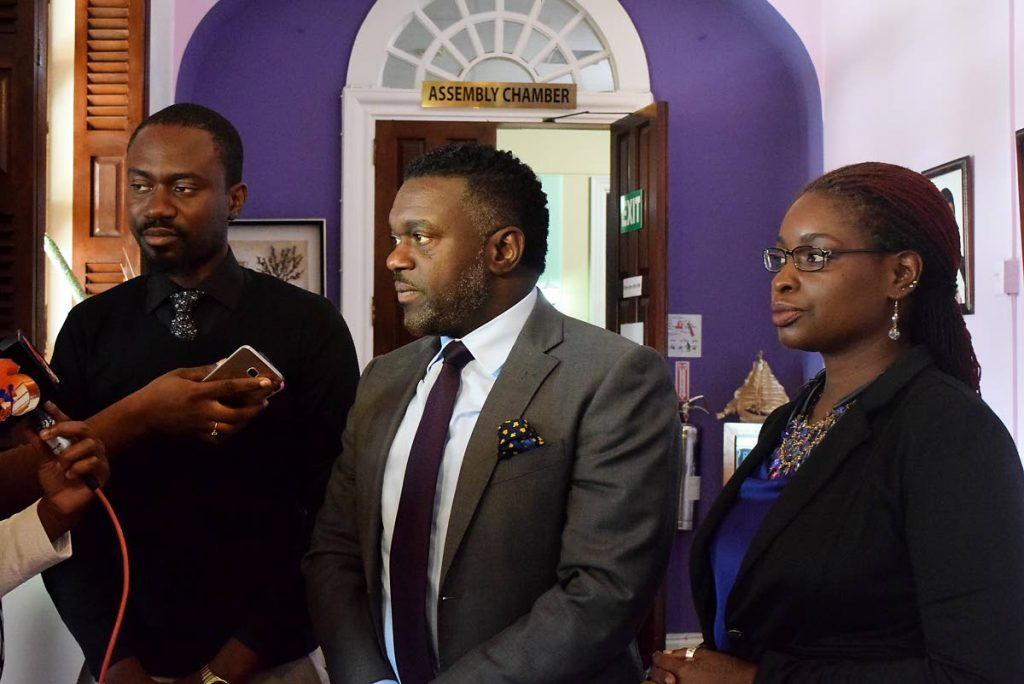 Minority leader Watson Duke, centre. and Minority Assemblymen Farley Augustine, left, and Dr Faith BYisrael talk to the media at the Tobago House of Assembly Legislature, Scarborough. -