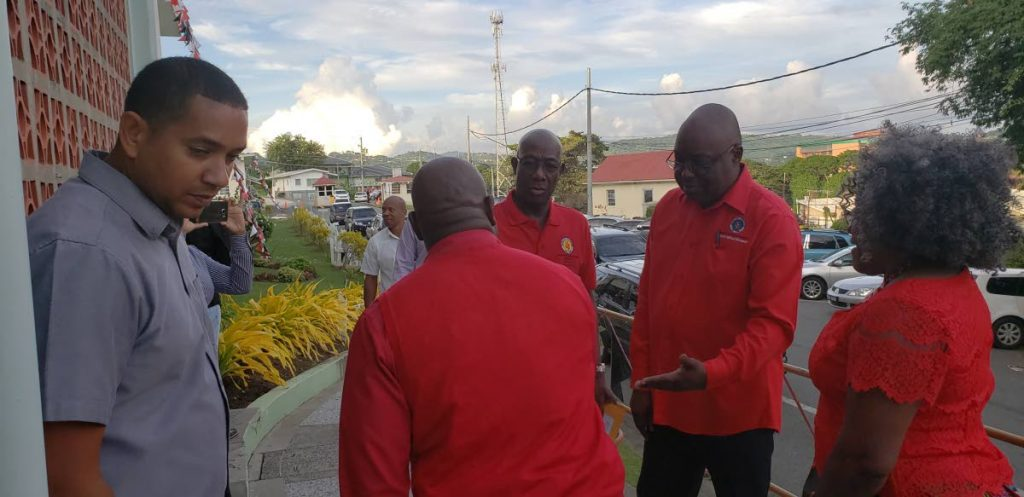In this September 2018 file photo, Prime Minister Dr Keith Rowley, centre, is greeted by Chief Secretary Kelvin Charles, right, as he arrives at the  PNM Tobago Council's convention at Shaw Park. This year's convention takes place today in Mt Marie.