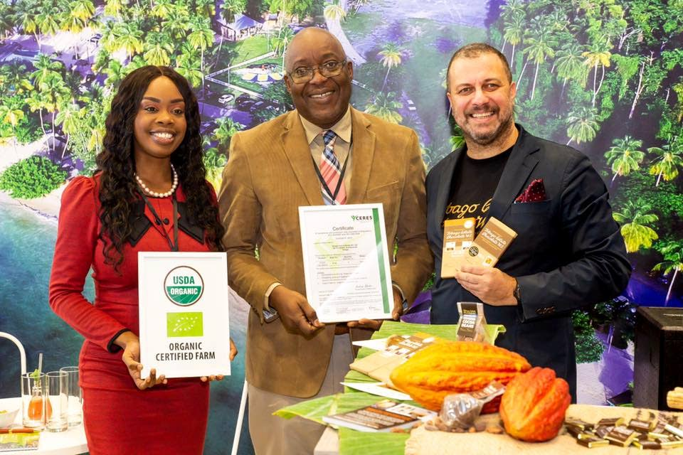 Chief Secretary Kelvin Charles, centre, Tourism Secretary Nadine Stewart-Phillips, left, and chocolate maker Duane Dove at ITB Berlin in Germany, the world's largest tourism and trade fair.