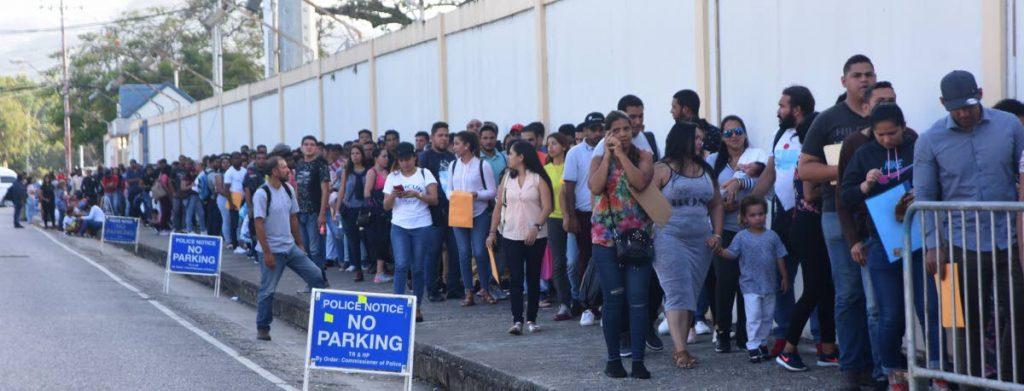 In this June 3, 2019 file photo, Venezuelans line up to register to work in TT for a year at Queen's Park Oval, Port of Spain.