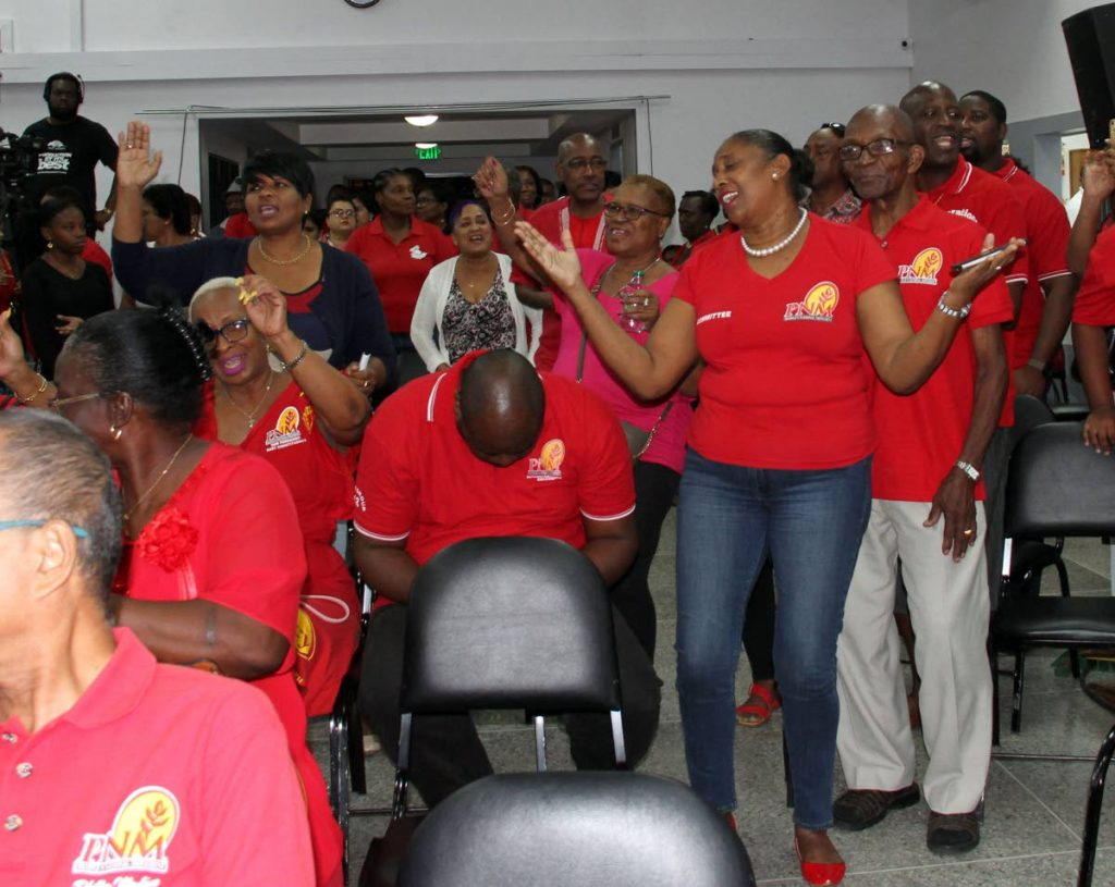 PNM supporters in an upbeat mood during a political meeting in Pleasantville in July. FILE PHOTO