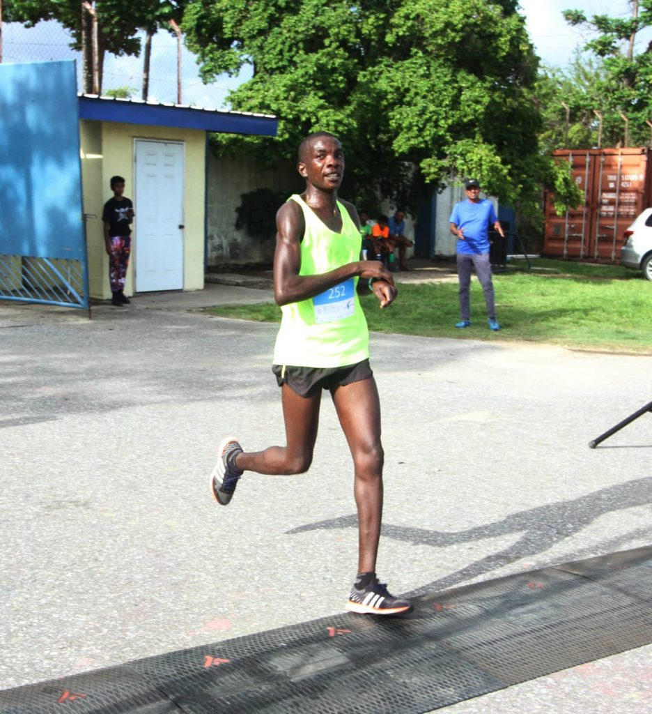 Alex Ekesa in action at the We Run Arima 5k, at the Arima Velodrome, on August 3. PHOTO BY ANGELO MARCELLE - ANGELO MARCELLE