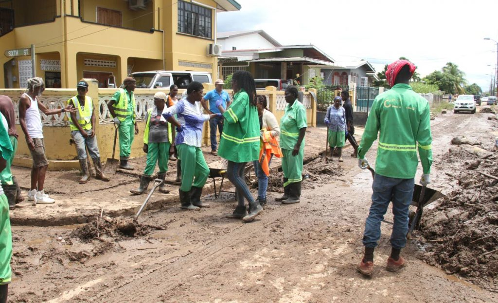 Community-Based Environmental Protection and Enhancement Programme (CEPEP) workers on a clean-up project in Mt Lambert after flooding in the area on September 23. PHOTO BY AYANNA KINSALE
