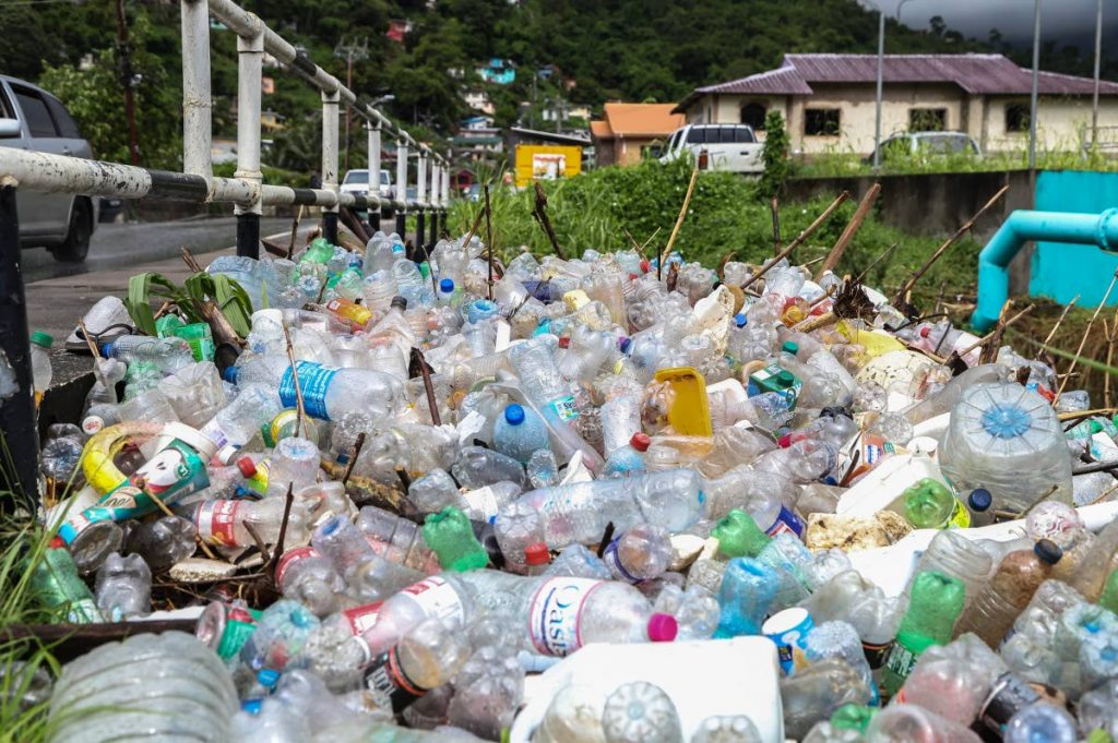 A pile of plastic bottles near the Diego Martin river, Sierra Leone Road after the area was flooded recently.  - JEFF K MAYERS