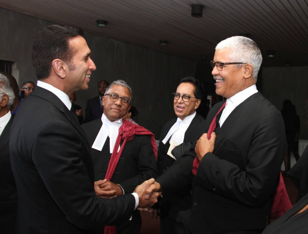 Senior counsel Reginald Armour (second from left) looks on as Attorney General Faris al-Rawi chats with Law Association president Douglas Mendes at the opening of the 2019/2020 law term. Armour also heads Dialogue Solutions Ltd which is recommending alternative dispute resolution as an ideal approach for reducing time and the cost of litigation in TT. FILE PHOTO