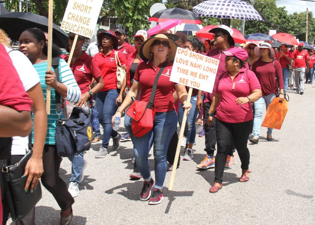 TTUTA representatives and teachers during a protest in Port of Spain over stalled salary negotiations. PHOTO BY AYANNA KINSALE