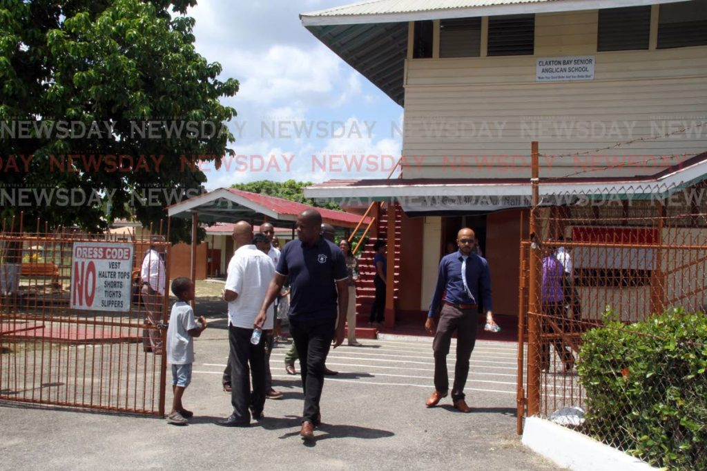 Minister in the Ministry of Education Dr Lovell Francis, ministry staff and NPTA representatives leave the Claxton Bay Junior Anglican School on Friday.   PHOTO BY VASHTI SINGH