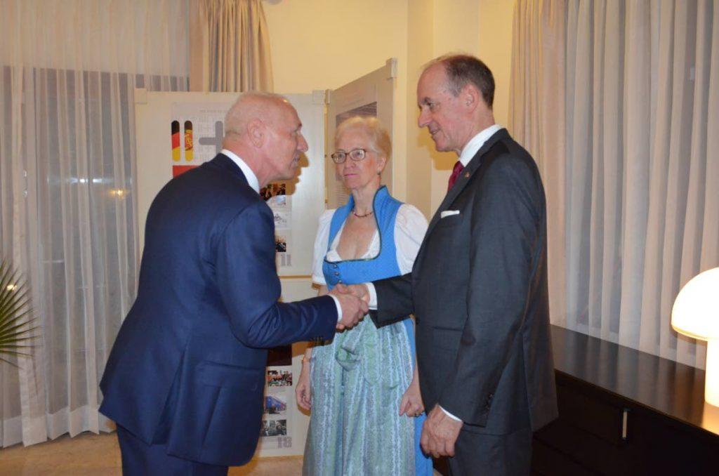 EU Ambassador Biesebroek, left, is welcomed by new German Ambassador Ute Konig and her husband Andreas Pfisterer.