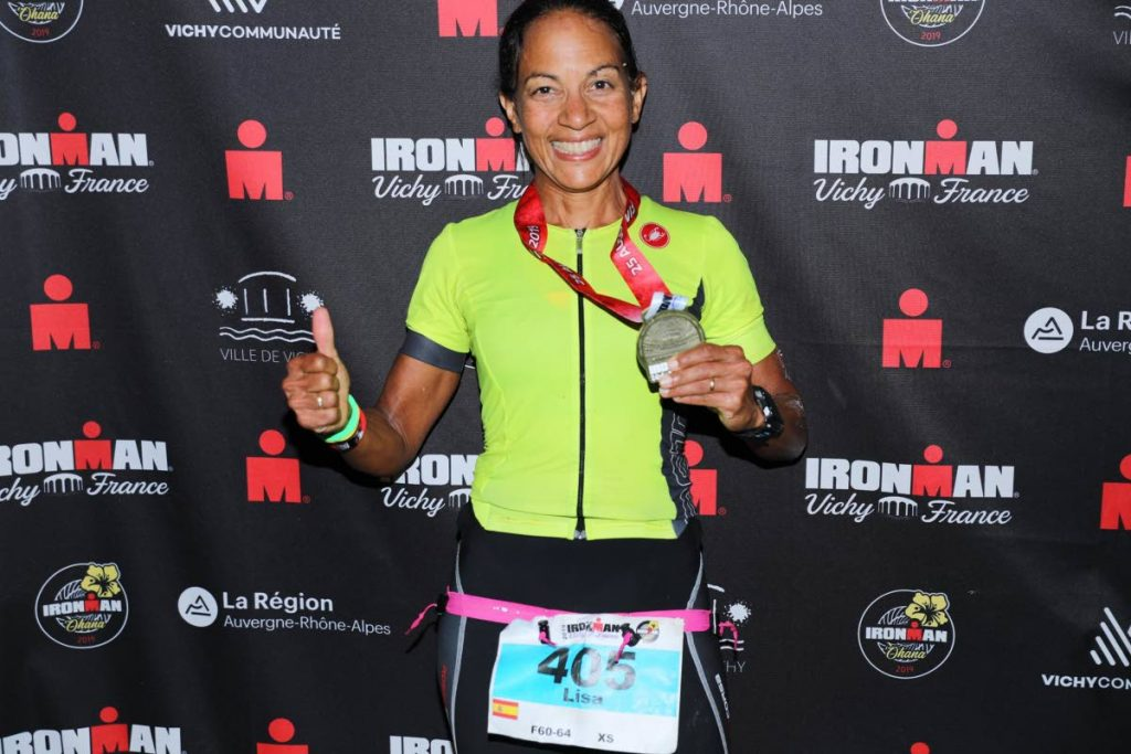 TT's Lisa Cockburn shows off her silver medal at the IronMan Vichy (triathlon) in France recently.