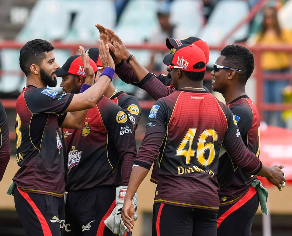 Members of the Trinbago Knight Riders celebrate a wicket against St Kitts/Nevis Patriots at the Guyana National Stadium on Sunday. TKR won the game by six wickets. PHOTO COURTESY CPL T20.