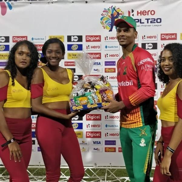 Brandon King (second from right) collects his Man of the Match hamper after yesterday's match. PHOTO COURTESY CPL T20.