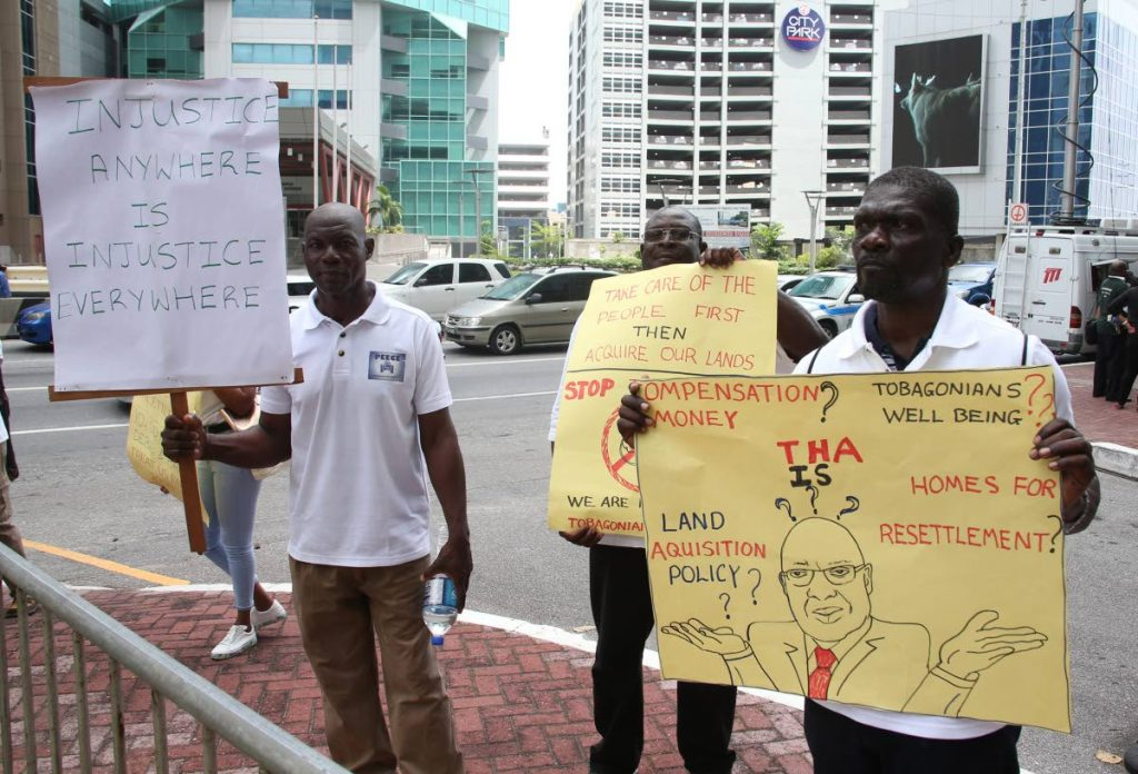 Members of the Provide Equivalent Equitable Compensation for Everyone movement protest outside Parliament during budget day in Port of Spain last Monday.