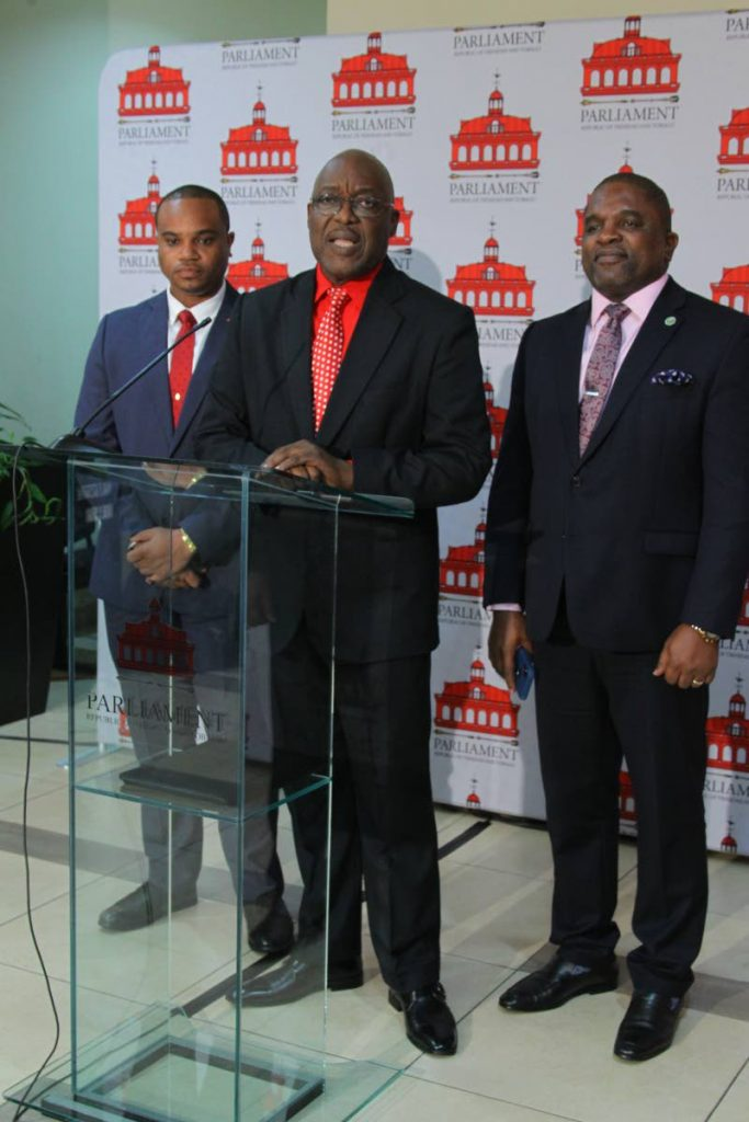 THA Chief Secretary Kelvin Charles, centre, Finance and Economy Secretary Joel Jack, right, and Assemblyman Kwesi Des Vignes speak to the media at the Parliament Chamber, Tower D, Waterfront, Port of Spain, Monday.