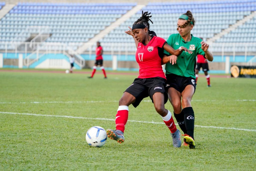 TT's Aaliyah Prince, left, on the ball against St Kitts and Nevis in the Concacaf Women's Olympic Zone Qualifiers, at the Ato Boldon Stadium, Couva,on Sunday. PHOTO BY DANIEL PRENTICE/CA-images