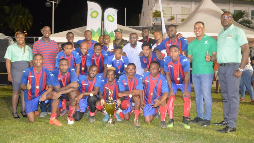 Prime Minister Dr. Keith Rowley (second from left) joins players and officials as First Engineer Battalion celebrate their victory in the final of the 2019 BPTT Carenage All-Star Football League played at the Carenage Recreation Ground on Saturday. Also sharing in the special occasion are Joel Primus (second from right), Community Sustainability and Stakeholder Relations Advisor, BPTT; Kyron Williams (right), President, FFCG; and Nicola Johnson-Williams, events coordinator, FFCG.