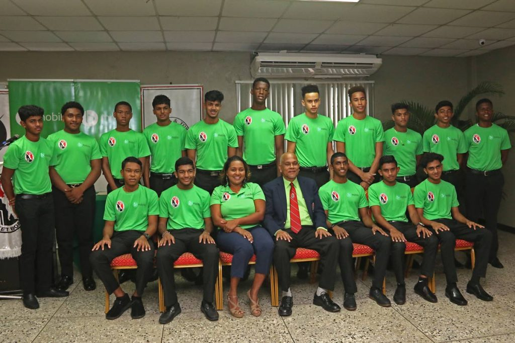 TSTT manager, corporate responsibility and community relations coporate communications, Anjanie Ramesar-Soom (seated third from left) and TT Cricket Board president Azim Bassarath(seated at centre)take a group with the bmbile/TTCB Youth Academy inductees at the National Cricket Centre,Balmain, Couva, yesterday.