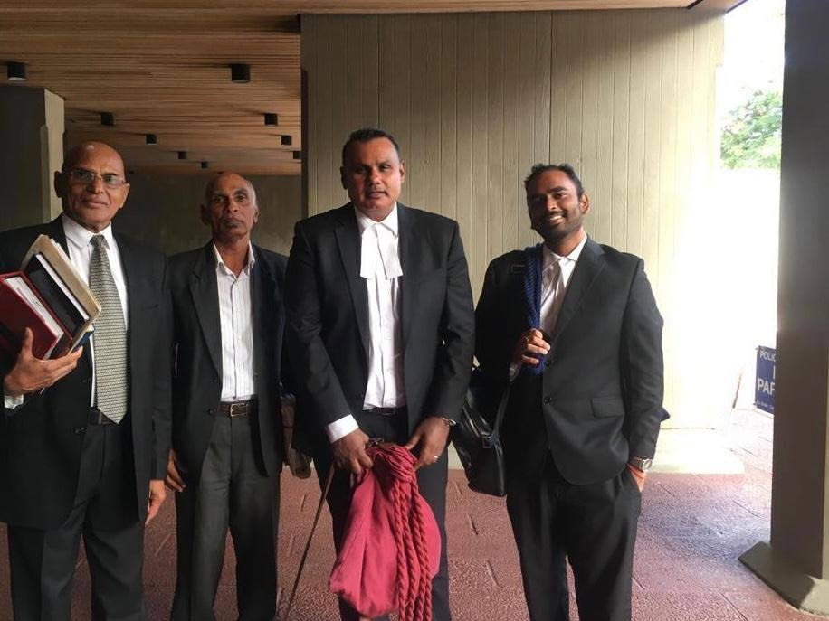 Attorney Reynold Waldropt, Anthony Waldropt, chief executive officer of Eastern Engineering, and attorneys Kelvin Ramkissoon and Leon Kallicharan.