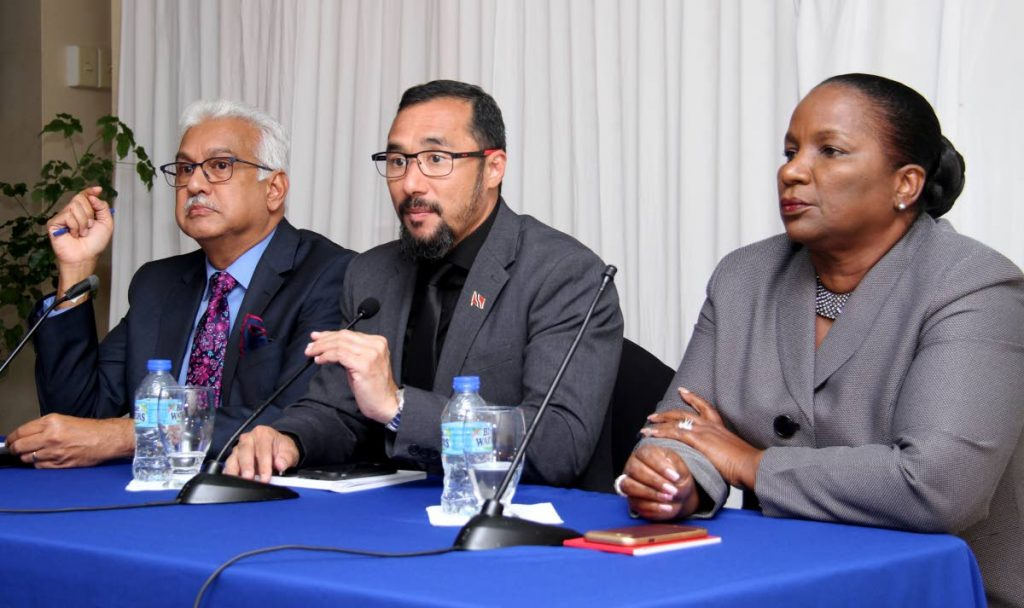Minister of National Security Stuart Young, centre, speaks at a press conference held at the Ministry of National Security. Flanking him are Minister of Health Terrence Deyalsingh, left, and Minister of Social Development and Family Services Cherrie-Ann Crichlow-Cockburn.