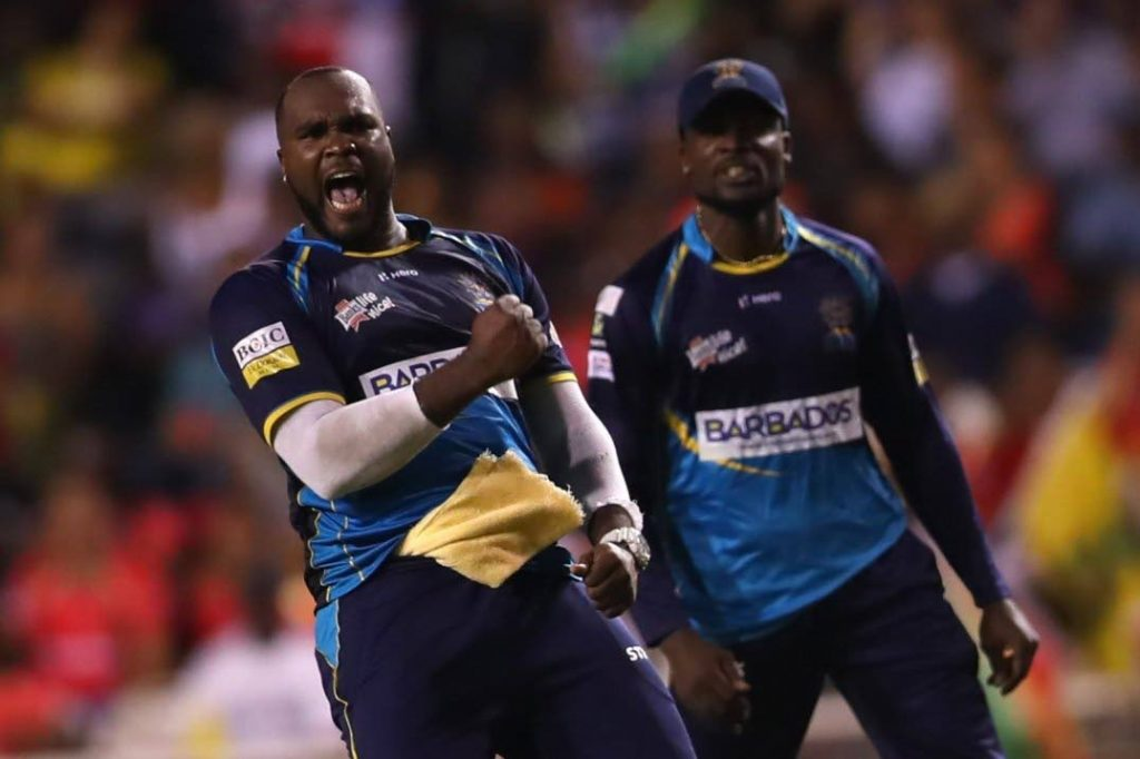 Barbados Tridents' Ashley Nurse (left) and Jonathan Carter celebrate a wicket in Saturday's Hero CPL T20 final against the Guyana Amazon Warriors at the Brian Lara Stadium, Tarouba. The Tridents won the game by 27 runs. PHOTO COURTESY HERO CPL T20 -
