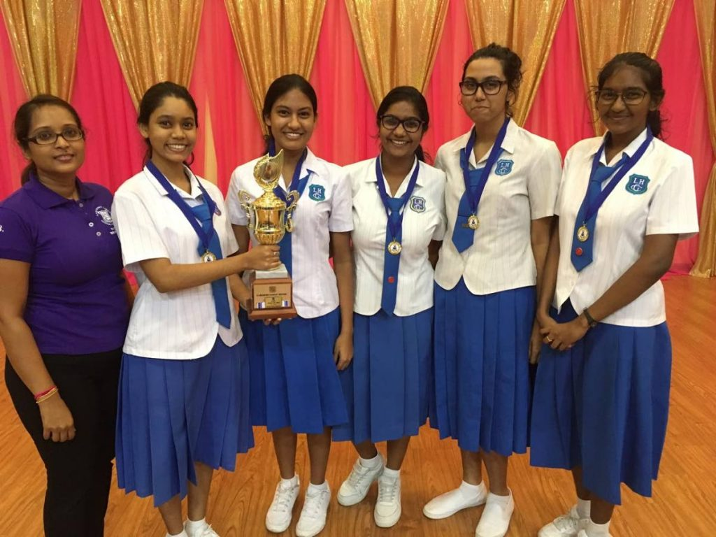 Student winners of the macaroni bridge STEM challenge with teacher Chandra Balroop.