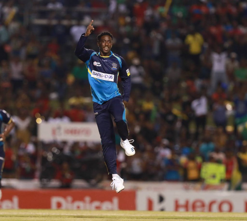 Hayden Walsh jr of the the Barbados Tridents celebrates a wicket  during the 2019 Hero CPL final against the Guyana Amazon Warriors at the Brian Lara Cricket Academy,Tarouba,on Saturday night.