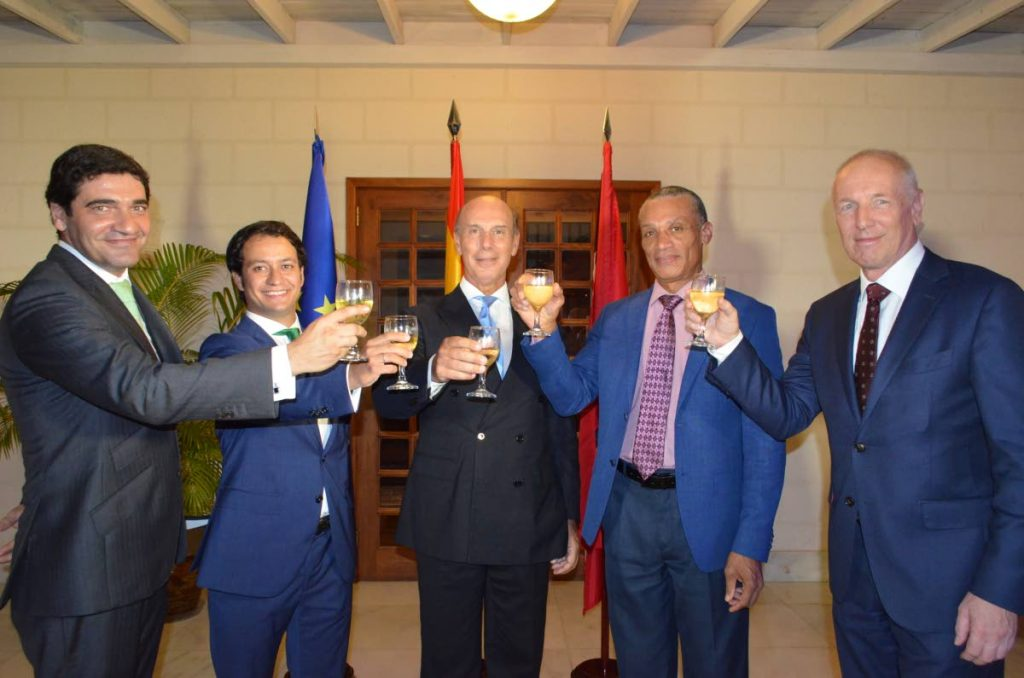 Toasting to Spain's national day are Vincente Cacho, Spanish Consul from left, Baltasar Fernández Melgosa, deputy head of the Spanish mission, Spanish Ambassador Javier María Carbajosa Sánchez, Dennis Moses, Minister of Foreign and Caricom Affairs and EU Ambassador Aad Biesebröek. - Joan Rampersad