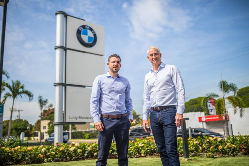LAFAST Motors general manager Jean Paul Agostini and director Gregory Farah poses with a BMW motor car.  PHOTO COURTESY LAFAST MOTORS -