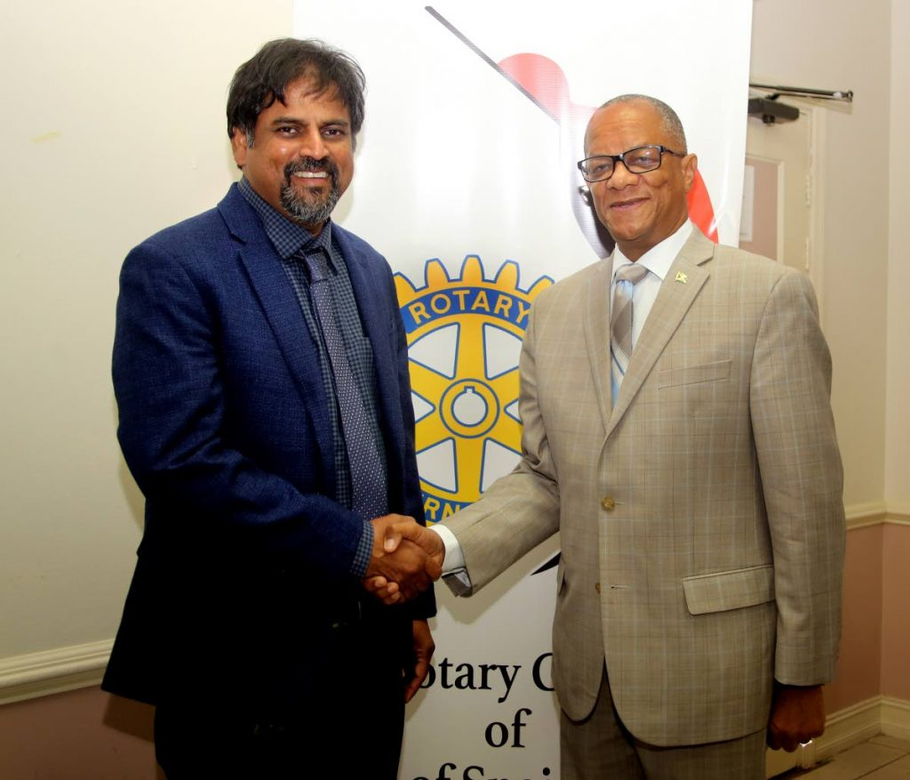 High Commissioner of Jamaica, Arthur Williams (right), is greeted by Rotary Club of PoS West Frank Teelucksingh at the club's luncheon at Cascadia Hotel in St Ann's on Wednesday.  PHOTO BY SUREASH CHOLAI - Sureash Cholai